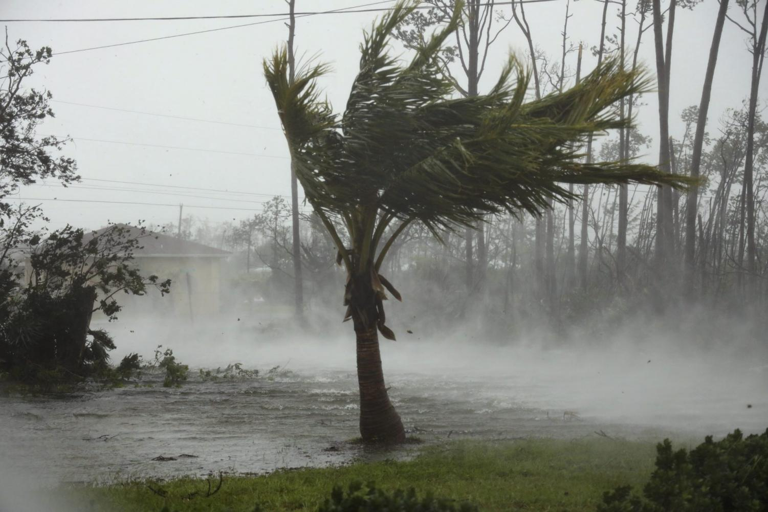 Hurricane Dorian hovered over the Bahamas on Monday, pummeling the islands with a fearsome Category 4 assault that forced even rescue crews to take shelter until the onslaught passes.