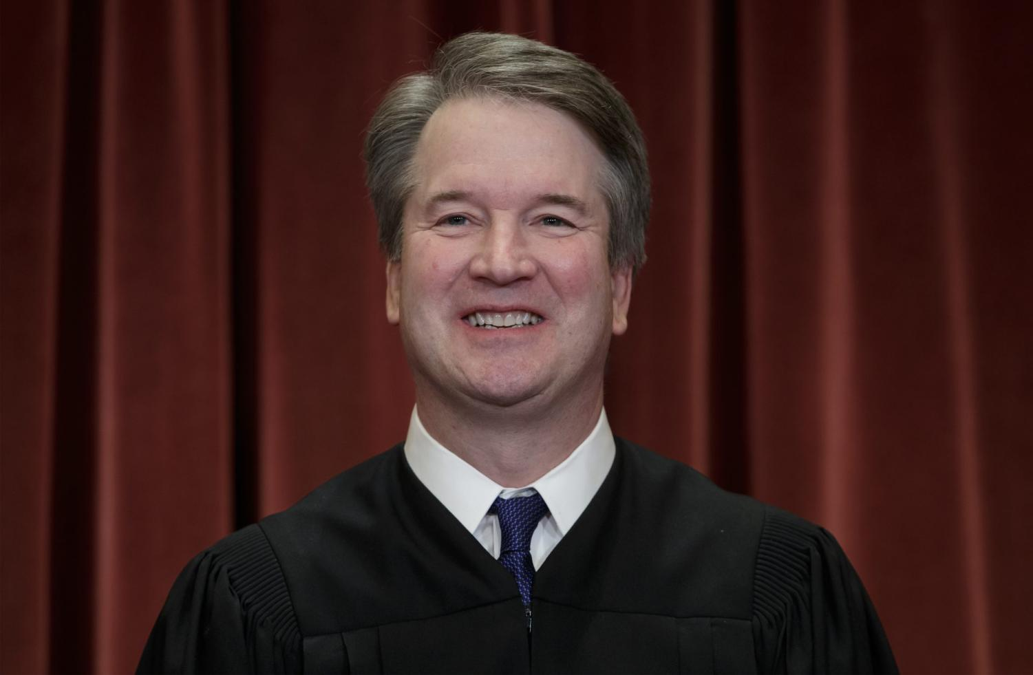 In this Nov. 30, 2018, file photo Associate Justice Brett Kavanaugh sits with fellow Supreme Court justices for a group portrait at the Supreme Court Building in Washington.
