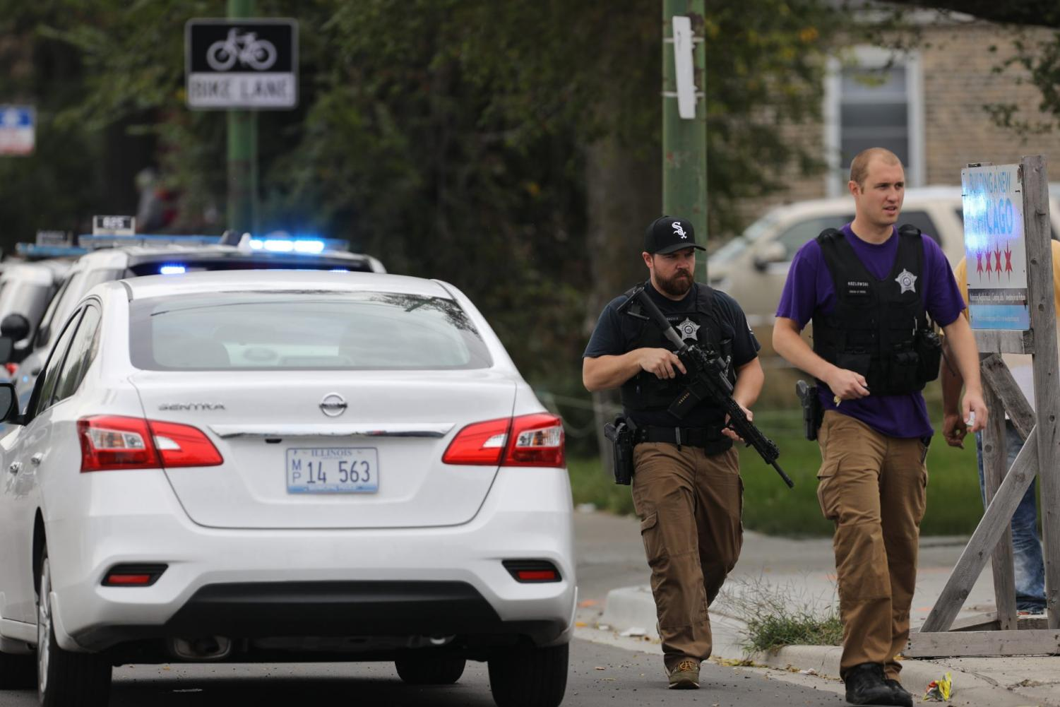 Police search for a suspect that shot a Chicago Police Department officer, near 63rd and Damen, Saturday, Sept. 21, 2019. The shooting happened around 8:40 a.m.
