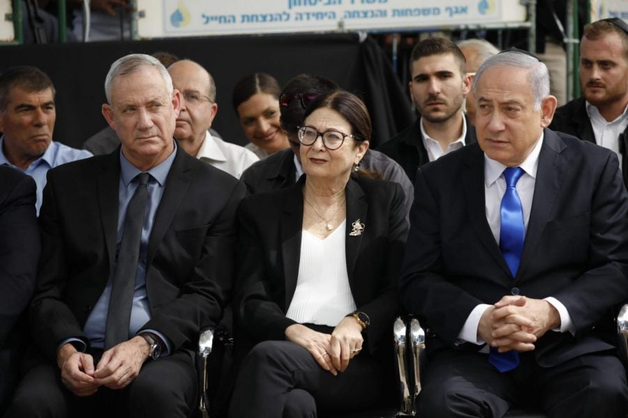 Blue and White party leader Benny Gantz, left, Esther Hayut, the Chief Justice of the Supreme Court of Israel, and Prime Minister Benjamin Netanyahu attend a memorial service for former President Shimon Peres in Jerusalem on Sept. 19, 2019.