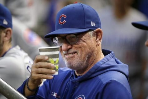 Chicago Cubs manager Joe Maddon salutes a fan from the dugout before a baseball game against the Pittsburgh Pirates in Pittsburgh, Wednesday, Sept. 25, 2019.