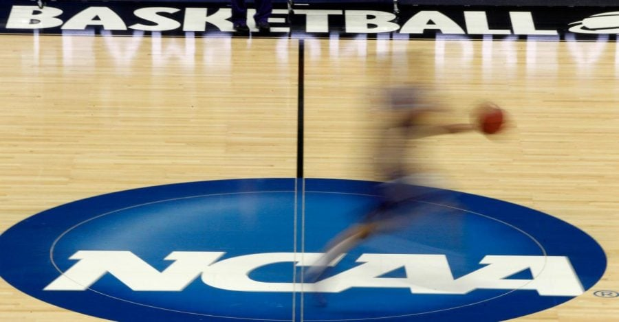 In this March 14, 2012, file photo, a player runs across the NCAA logo during practice in Pittsburgh.