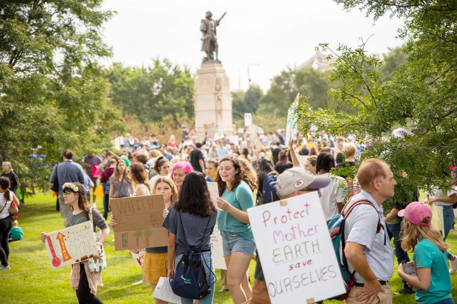 Protestors for the Youth Climate Offensive gather in Grant Park before a march to the Federal Plaza.