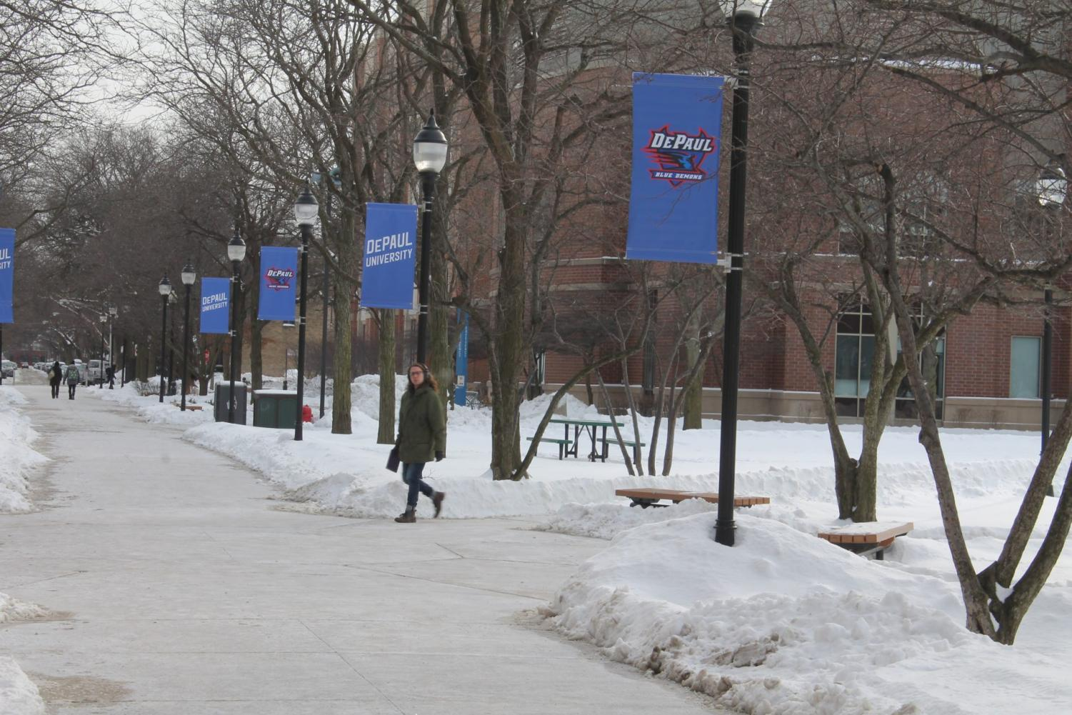 A student walks through the Quad on one of the coldest day's ever recorded in Chicago, Jan. 30, 2019. This day fell during the beginning of DePaul's Winter Quarter last year.