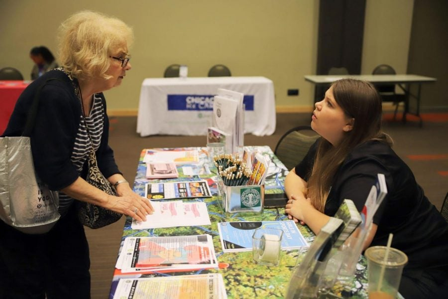 Marie Huels (right), who works in marketing with the Chicago Park District, speaks to Joan Bellagamba (left), Lincoln Park resident, about events hosted by the park district.
