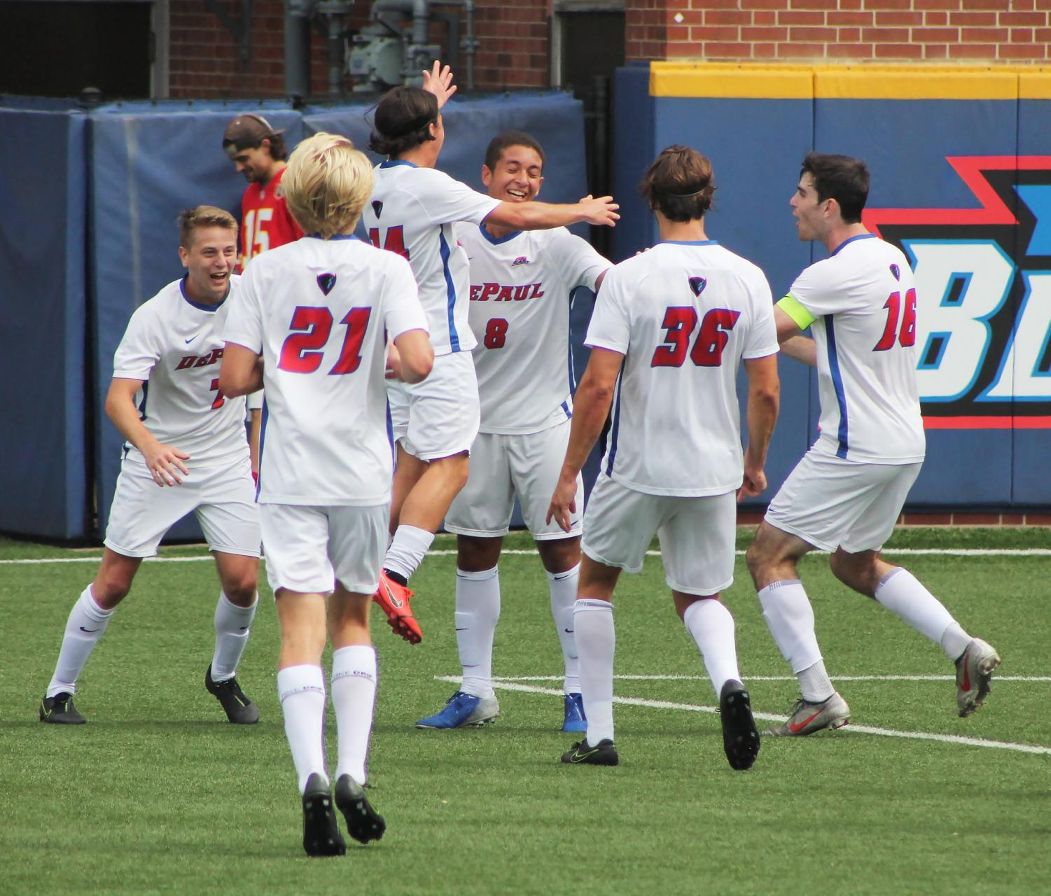 The DePaul Men's Soccer Team celebrate as Sophomore midfielder Youssef Ramadan scores the first goal of the game against Drake University. The Blue Demons beat Drake 3-0 on Monday at Wish Field.