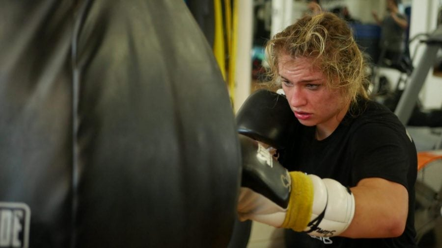 Summer Lynn works on her form, practicing on the bag during a training session at Body Shot Boxing Club in the Pilsen neighborhood.