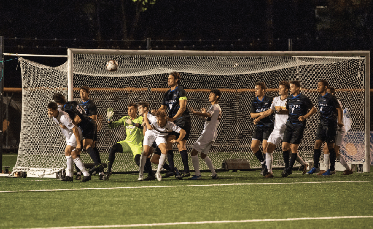 DePaul and Loyola soccer players fight for the ball during a Ramblers corner kick on Friday. DePaul fell to Loyola 4-2 at Hoyne Field.