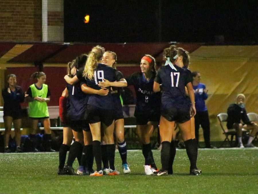 DePaul junior forward Morgan Turner celebrates with her team after scoring the second goal for DePaul. Turner's shot from outside the box put DePaul up for good.