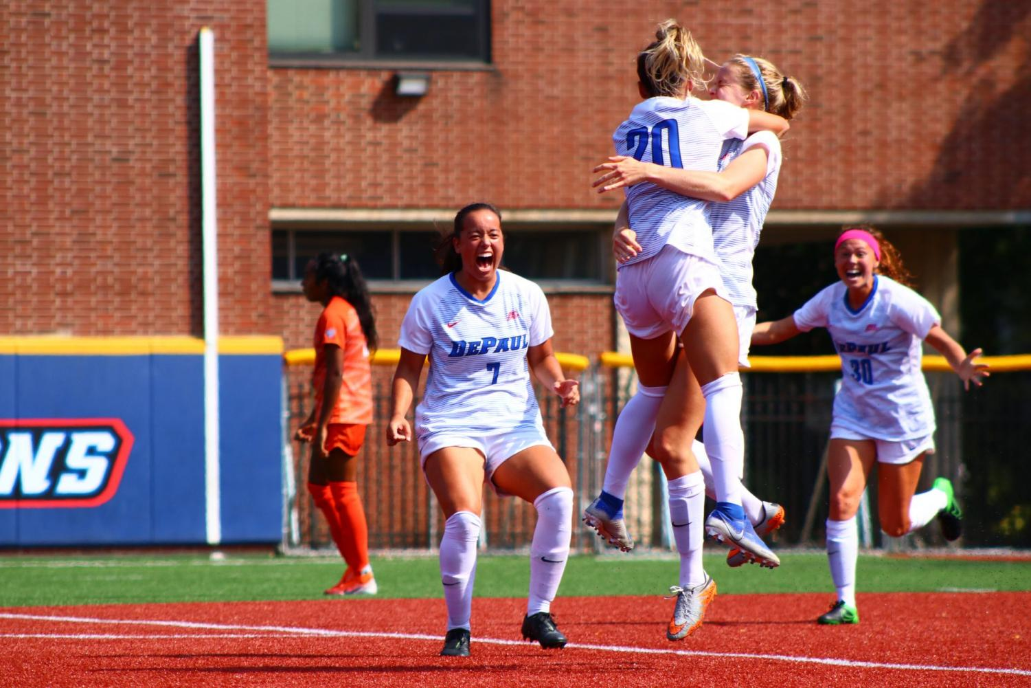 The DePaul Women's soccer team celebrate a goal by junior forward Megan Turner against Bowling Green on Sunday at Wish Field.