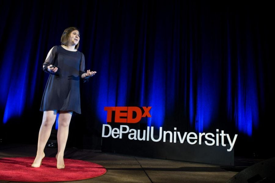 "In a performance from 2017, alumna Nelly Mueller presents her speech ""Careening Out of Complacency"" at TEDxDePaulUniversity. The course prepares students for performance and public speeches in a professional and recognizable environment."