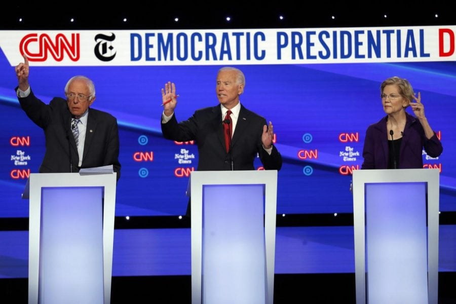 Democratic+presidential+candidate+Sen.+Bernie+Sanders%2C+I-Vt.%2C+left%2C+former+Vice+President+Joe+Biden+and+Sen.+Elizabeth+Warren%2C+D-Mass.%2C+right%2C+participate+in+a+Democratic+presidential+primary+debate+hosted+by+CNN%2FNew+York+Times+at+Otterbein+University%2C+Tuesday%2C+Oct.+15%2C+2019%2C+in+Westerville%2C+Ohio.