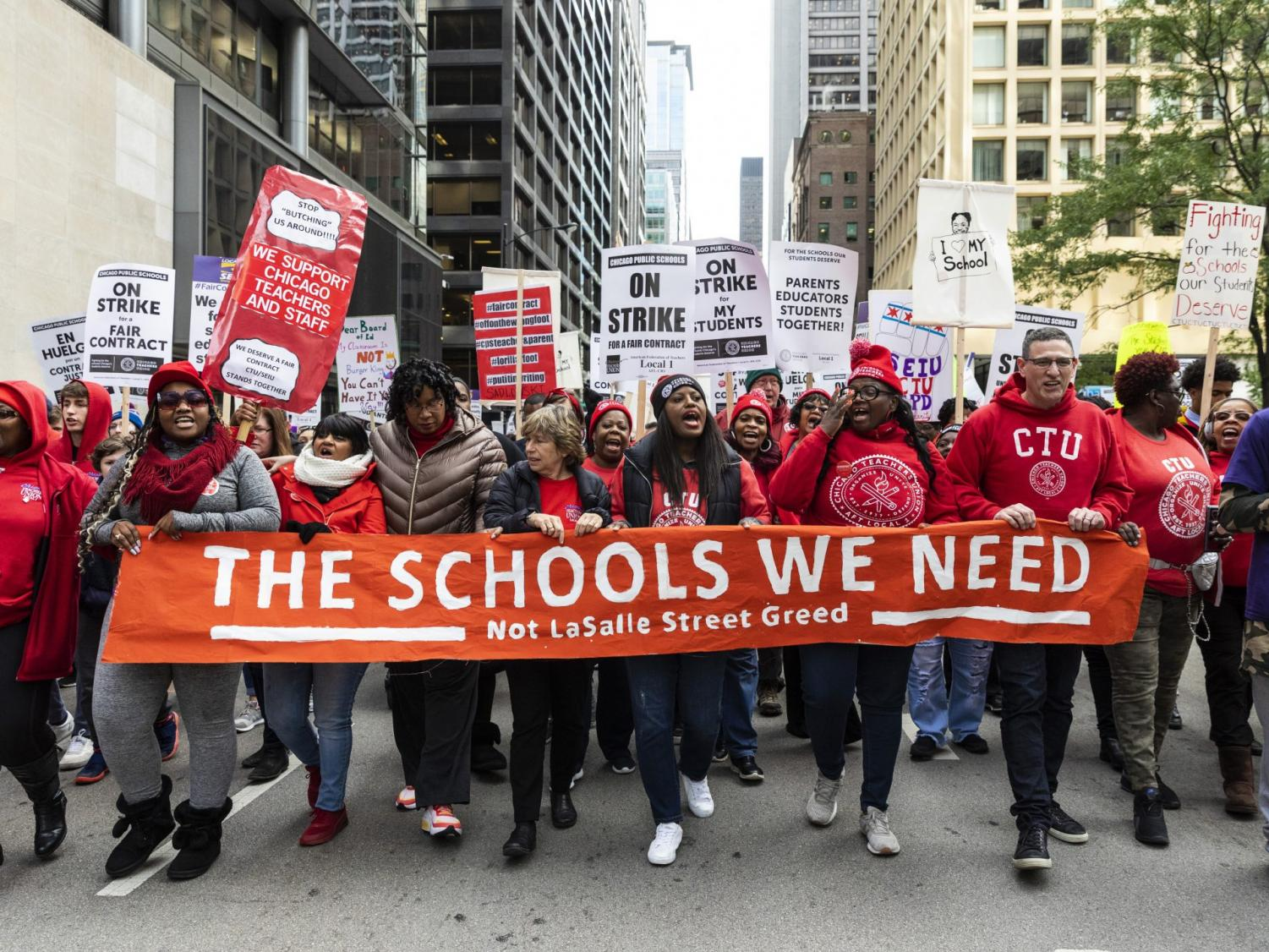 Chicago Teachers Union Vice President Stacy Davis Gates, center, other union officials and their supporters lead thousands of striking union members on a march through the Loop, Thursday, Oct. 17, 2019, in Chicago. Striking teachers went on strike after their union and city officials failed to reach a contract deal in the nation's third-largest school district.