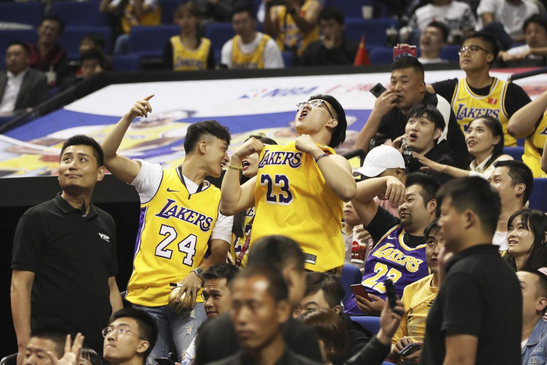 NBA fans react to a preseason game in Shanghai, China.