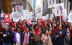 Warren joins striking Chicago teachers as negotiations stall