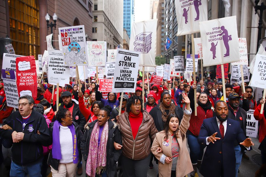 Members of the Chicago Teachers Union walk the streets of Chicago to strike for support staff members, smaller class sizes and paid prep time on Thursday, Oct. 17.