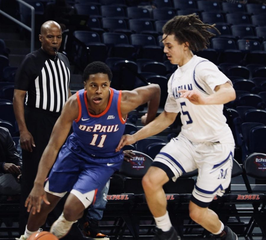 DePaul junior guard Charlie Moore drives past a Marian defender on Tuesday at Wintrust Arena.