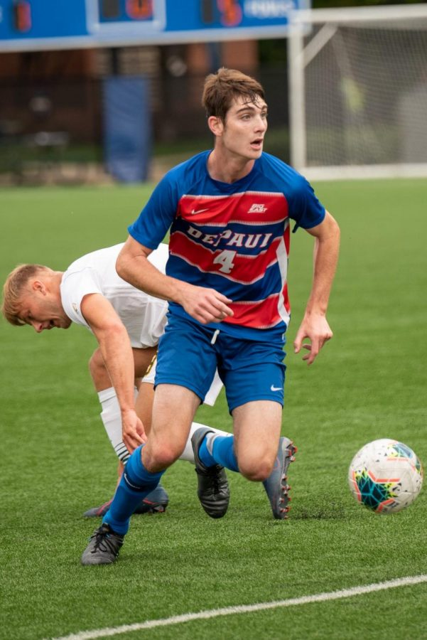 DePaul freshman defender Dan Iscra dribbles past a Vermont defender during a match on Sep. 1 at Wish Field. The Blue Demons lost the game 1-0.