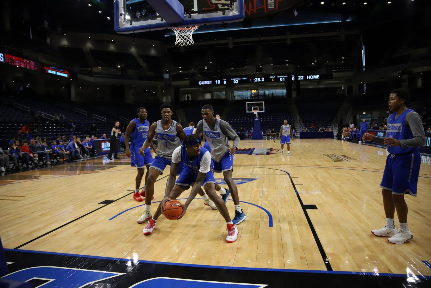 DePaul sophomore forward Darious Hall comes down with a rebound in the Blue Demons' open scrimmage on Saturday.