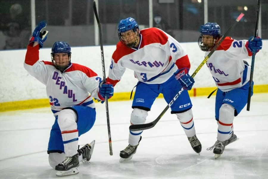 DePaul winger Connor McNally (left) celebrates with teammates after scoring a goal against Illinois in the second period on Friday.