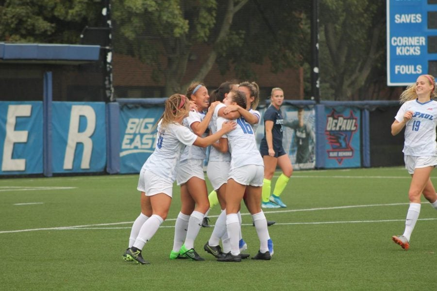 DePaul+celebrates+a+goal+scored+by+freshman+forward+Kristin+Boos%2C+the+first+goal+scored+in+the+game+against+Butler+University+at+Wish+Field+on+Thursday.+DePaul+won+against+Butler+2-1.