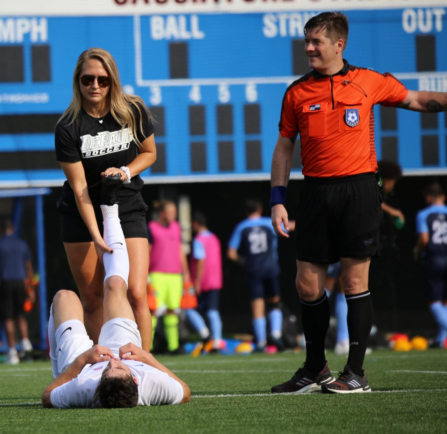 Allison Podborny stretches out an injured DePaul men's soccer player during a contest against Villanova on Friday, Sept. 20 at Wish Field.