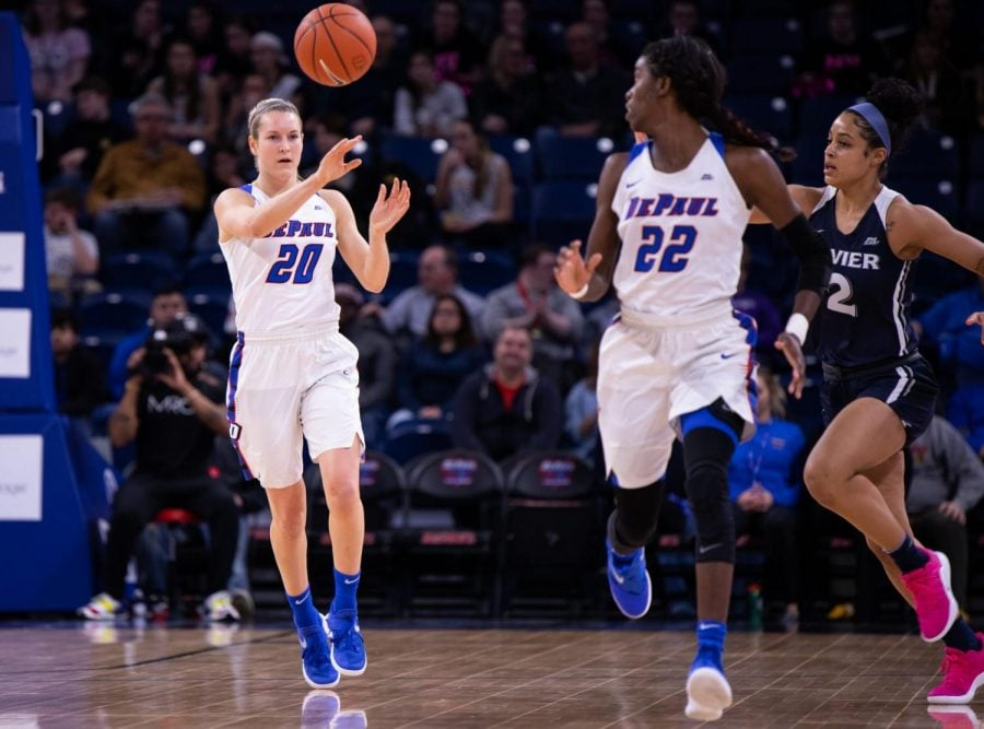 DePaul+senior+Kelly+Campbell+passes+the+ball+to+her+fellow+senior+teammate+Chante+Stonewall.+