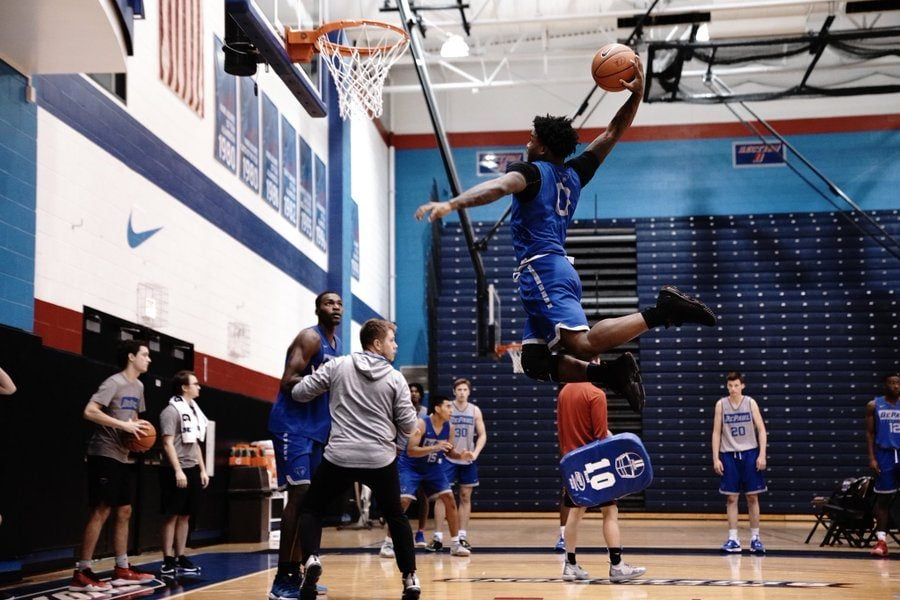 DePaul freshman Markese Jacobs goes up for a dunk during one of the Blue Demons' practice. Jacobs is still recovering from a partially torn ACL.