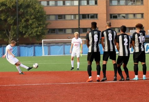 Men's soccer rolls past Providence on alumni day