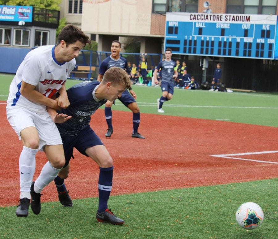 Senior midfielder Zach El-Shafei (left) fights for the ball against Georgetown junior defender Sean O'Hearn on Friday at Wish Field. DePaul tied Georgetown 0-0 in double-overtime.