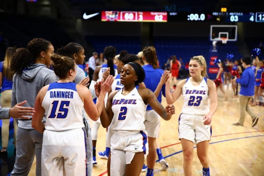 The DePaul women's basketball team walks off the court after defeating St. Xavier 124-60 at Wintrust Arena.