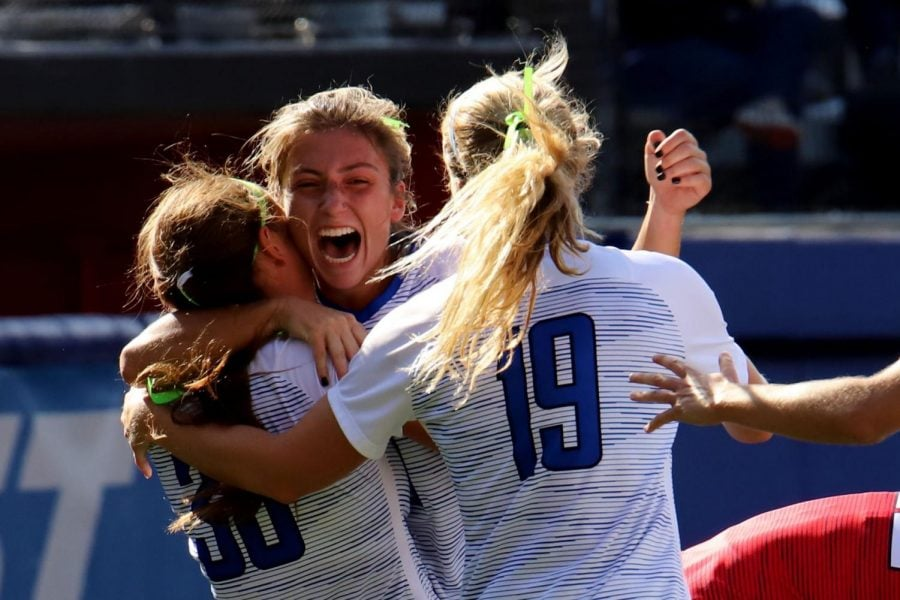 DePaul junior midfielder Bina Saipi celebrates with her teamamtes after scoring a goal against St. John's at Wish Field on Sunday. The Blue Demons won the game 2-0.