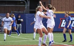 The DePaul women's soccer team celebrates together after scoring a goal against Seton Hall on Saturday at Wish Field. The Blue Demons won the game 4-0.
