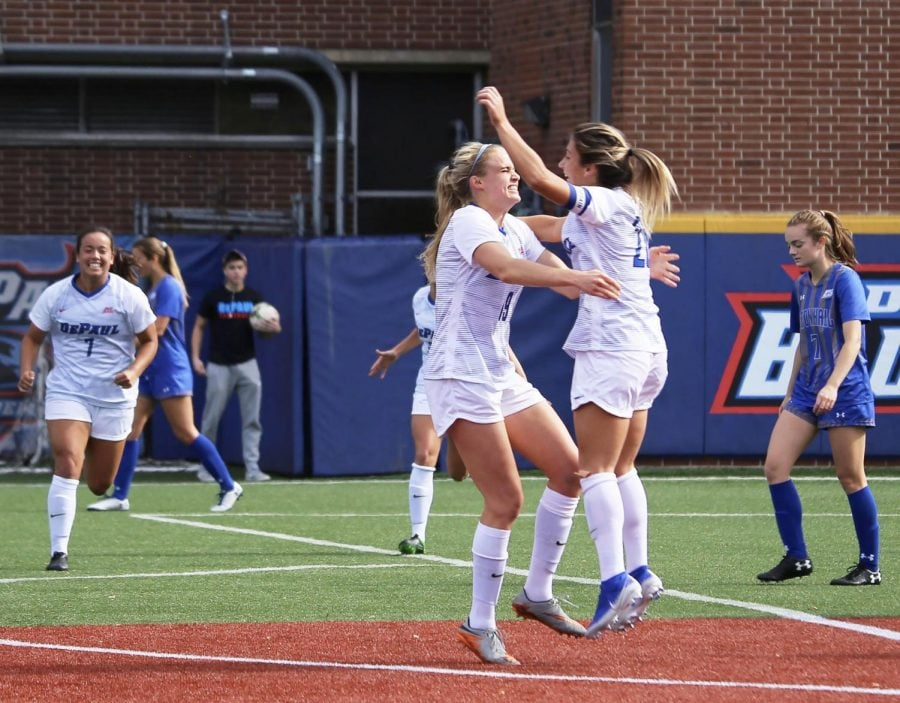 The+DePaul+women%E2%80%99s+soccer+team+celebrates+together+after+scoring+a+goal+against+Seton+Hall+on+Saturday+at+Wish+Field.+The+Blue+Demons+won+the+game+4-0.