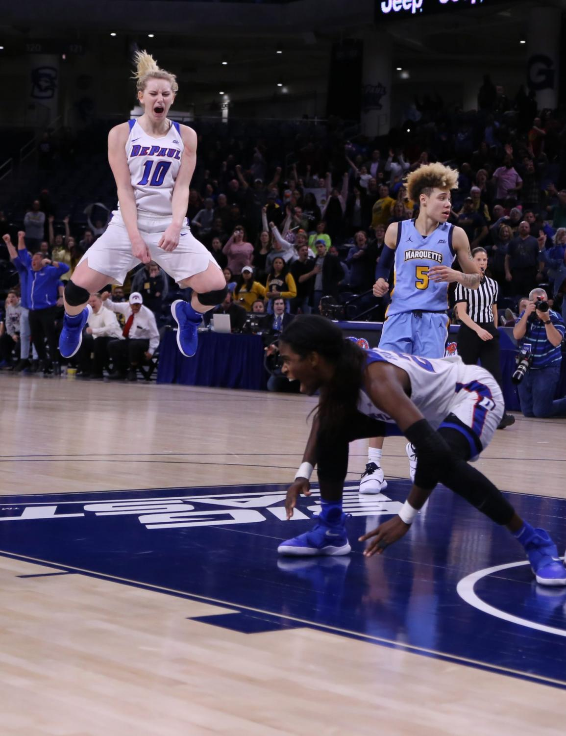 Lexi Held and Chante Stonewall celebrate after Stonewall hit a game-winning shot in the 2019 Big East championship game on March 12 at Wintrust Arena.