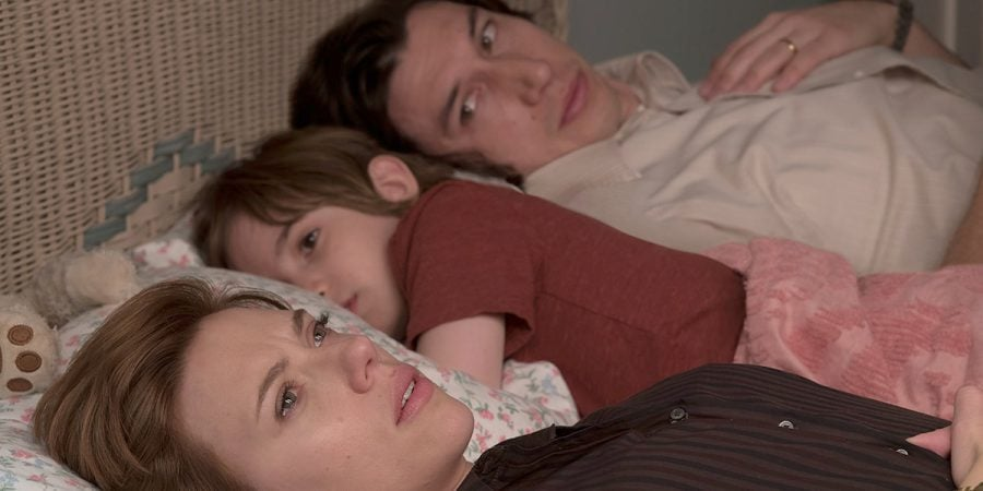 Nicole Barber, played by Scarlett Johansson, holds back tears in bed with her husband, Charlie (Adam Driver), and child. Photo by IMDB