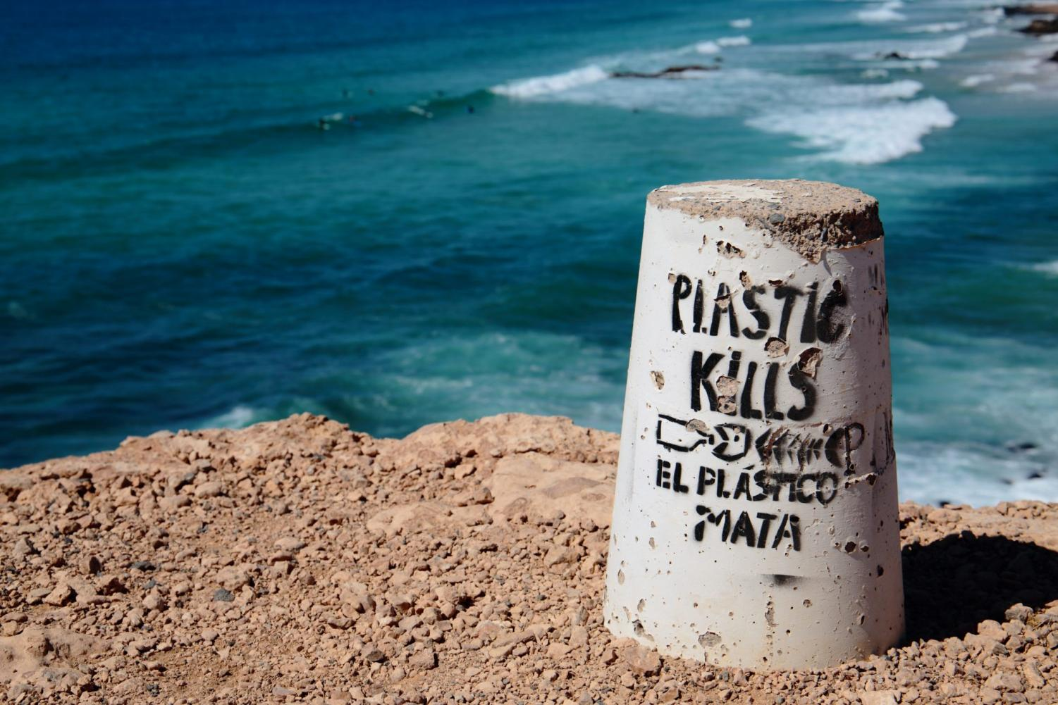 This April 6, 2018 photo shows an anti-pollution message in Fuerteventura, the second-largest of the seven Canary Islands. Experts say chemical pollution from farming and industrial runoff poses an even greater threat than plastics.