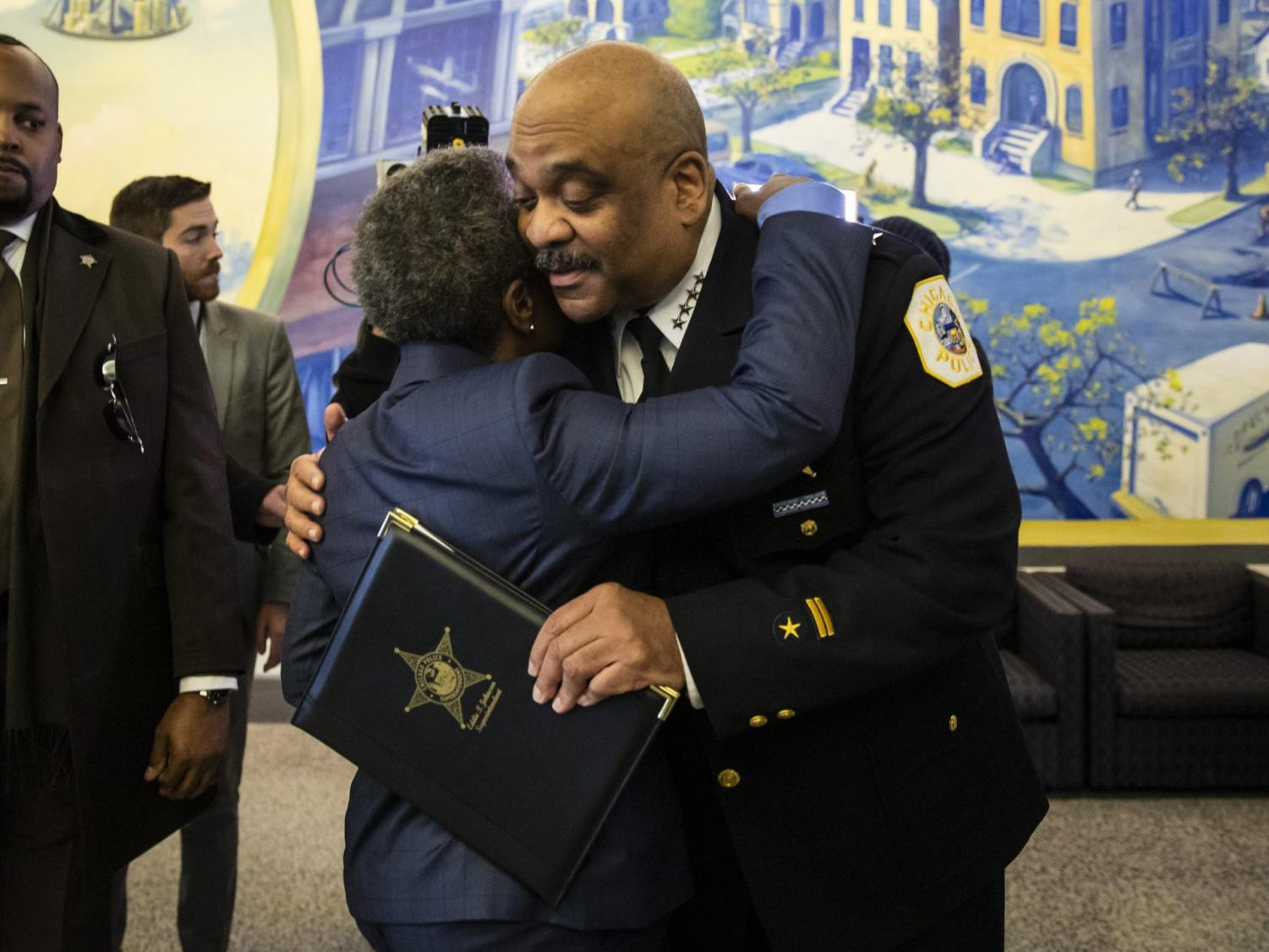 Chicago Police Department Supt. Eddie Johnson hugs Mayor Lori Lightfoot after he announced his retirement during a press conference at CPD headquarters, Thursday morning, Nov. 7, 2019.