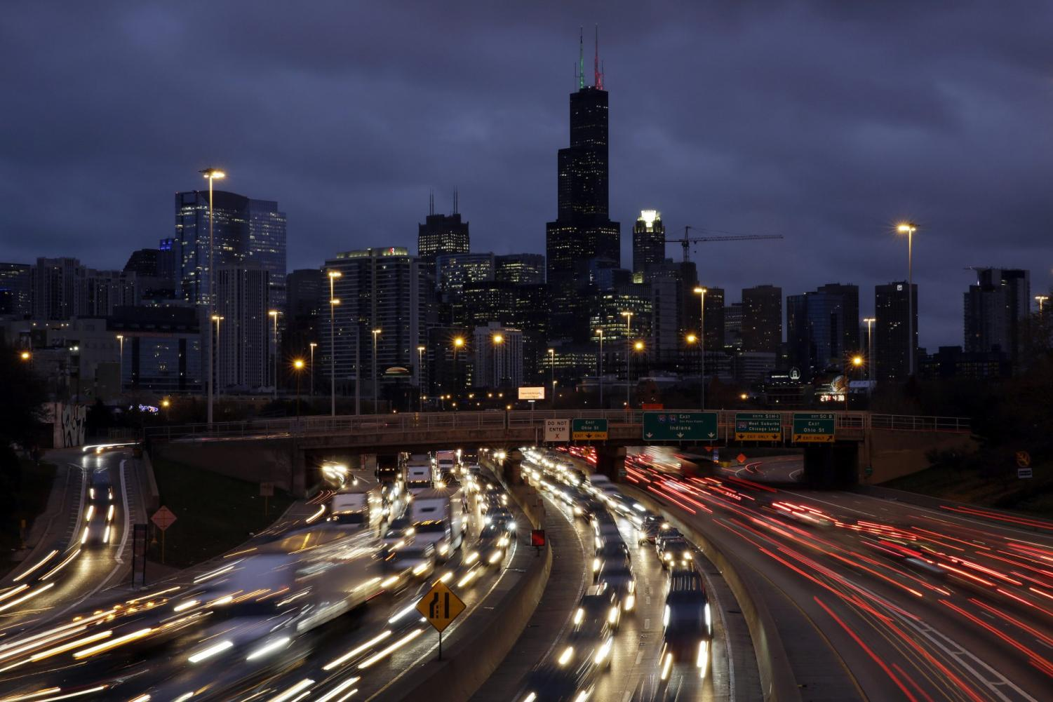 In this Nov. 21, 2018, file photo taken with a long exposure, traffic streaks across the John F. Kennedy Expressway at the start of the Thanksgiving holiday weekend in Chicago. The Transportation Security Administration said Wednesday, Nov. 13, 2019, that it expects to screen more than 26.8 million passengers from Nov. 22 through Dec. 2, a 4% increase over the comparable period last year.