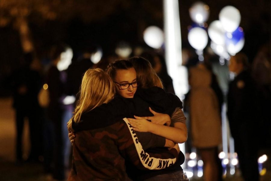 Students embrace during a vigil at Central Park in the aftermath of a shooting at Saugus High School Thursday, Nov. 14, 2019, in Santa Clarita, Calif. Los Angeles County sheriff's officials say a 16-year-old student shot five classmates and then himself in a quad area of Saugus High School Thursday morning.