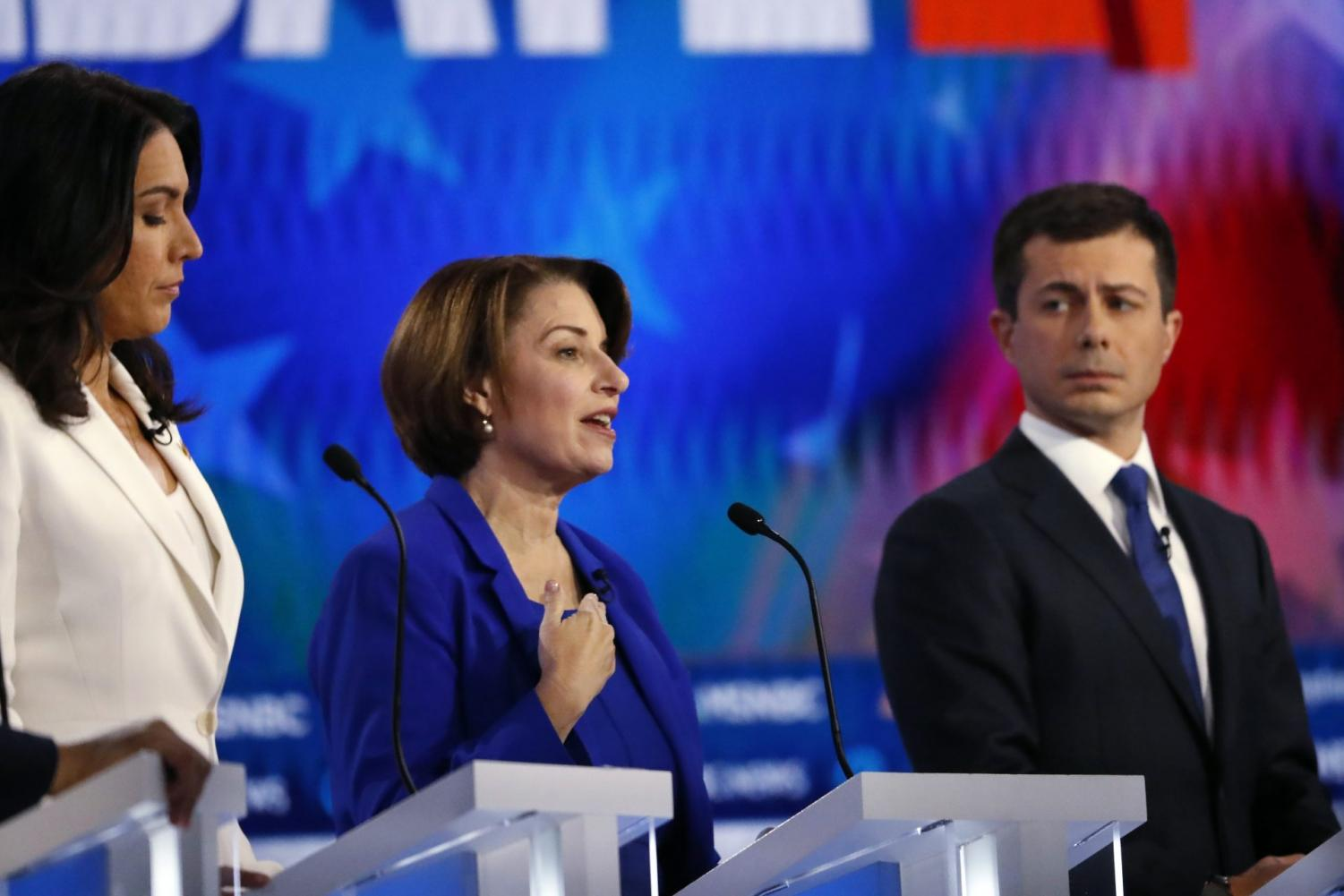 Democratic presidential candidates Rep. Tulsi Gabbard, D-Hawaii, Sen. Amy Klobuchar, D-Minn., and South Bend, Ind., Mayor Pete Buttigieg, from left, participate in a Democratic presidential primary debate, Wednesday, Nov. 20, 2019, in Atlanta.