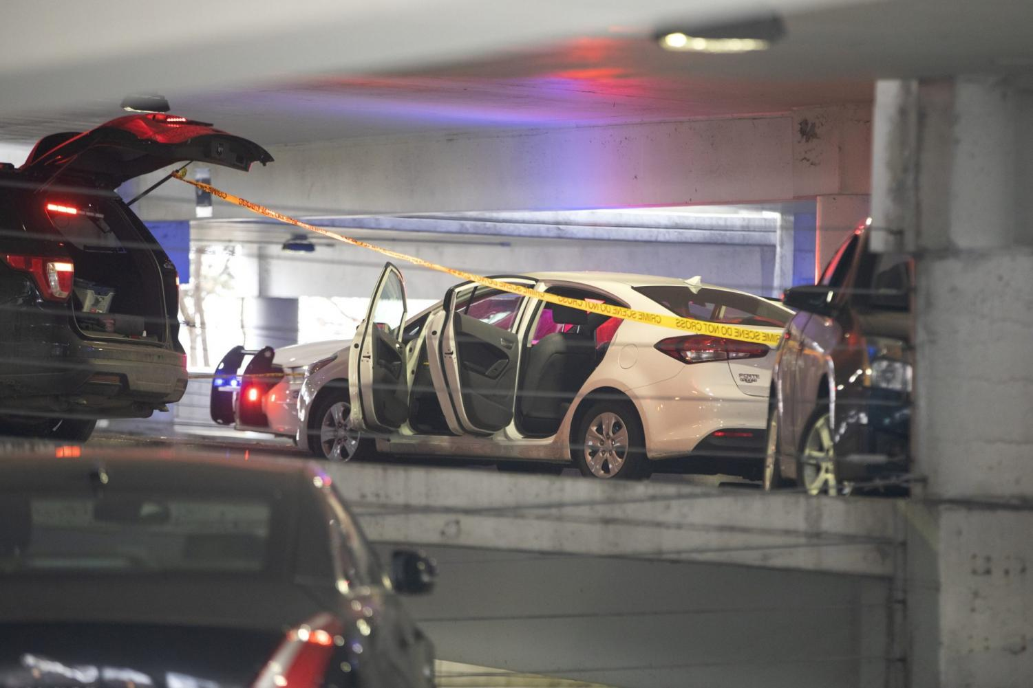 A white vehicle is parked at the scene of a death investigation in a University of Illinois at Chicago parking garage Saturday, Nov. 23, 2019, in Chicago. Authorities say the body of a missing University of Illinois at Chicago student has been found in a car inside campus parking garage.The Cook County medical examiner identified the woman found Saturday as 19-year-old Ruth George of Berwyn.