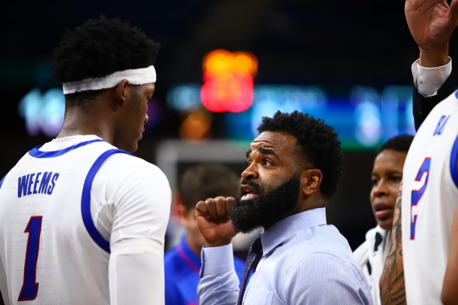 DePaul interim head coach Tim Anderson talks with freshman forward Romeo Weems during DePaul's game against the University of Chicago on Wednesday at Wintrust.
