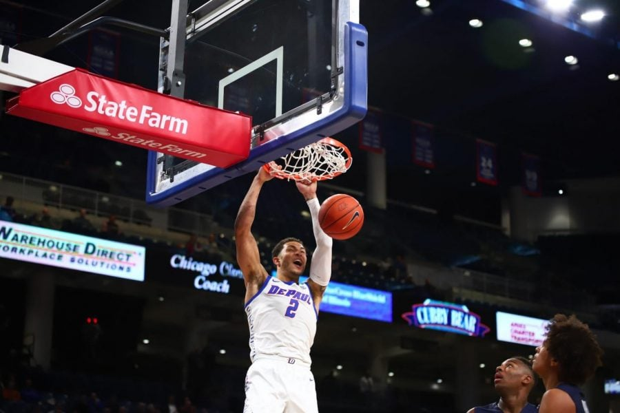 DePaul junior forward Jaylen Butz dunks the ball against Fairleigh Dickinson on Friday at Wintrust Arena