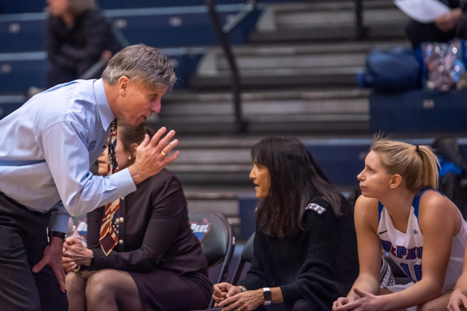 Head coach Doug Bruno talking to sophomore guard Lexi Held on the sideline of Monday night's win over Drexel at McGrath-Phillips Arena.