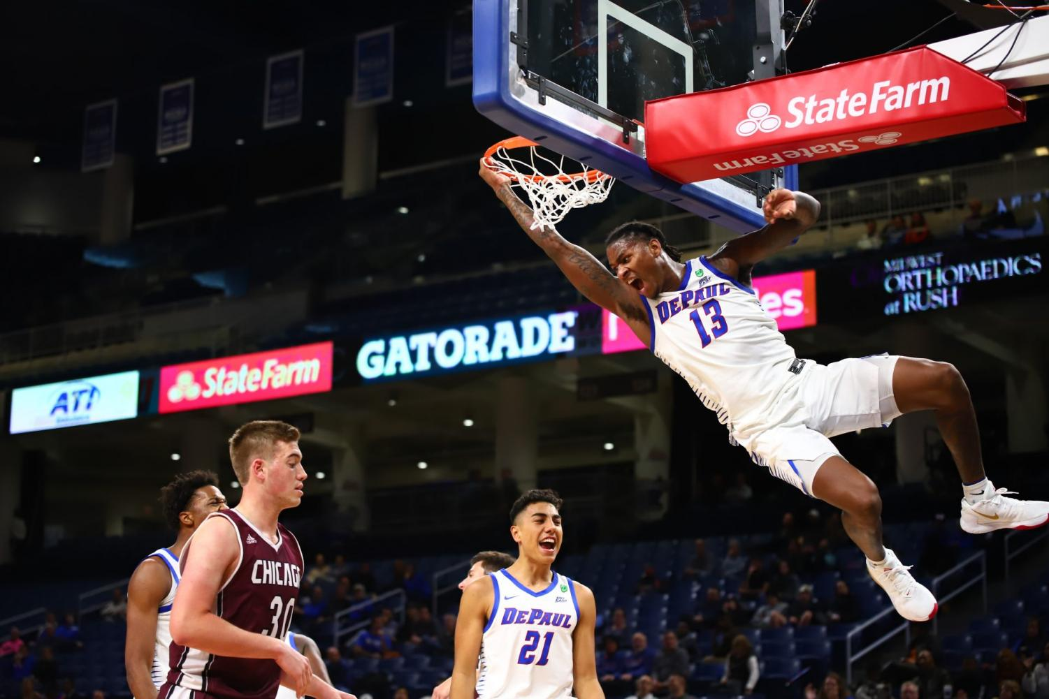 Sophomore guard Darious Hall celebrates a ferocious dunk in the second half against U Chicago on Tuesday night at Wintrust Arena.
