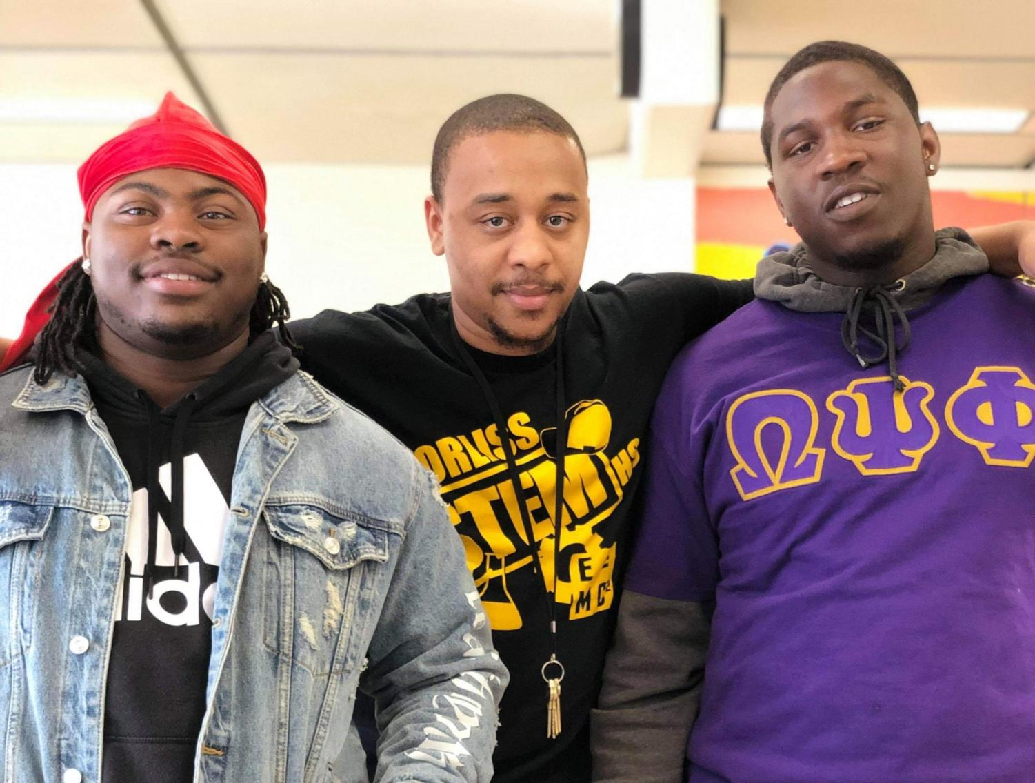 Trenton Sapp (middle) poses with two of his students, (left) Jivontae Price and (right) Courtney William. Sapp teaches that success can come from any part of the city.