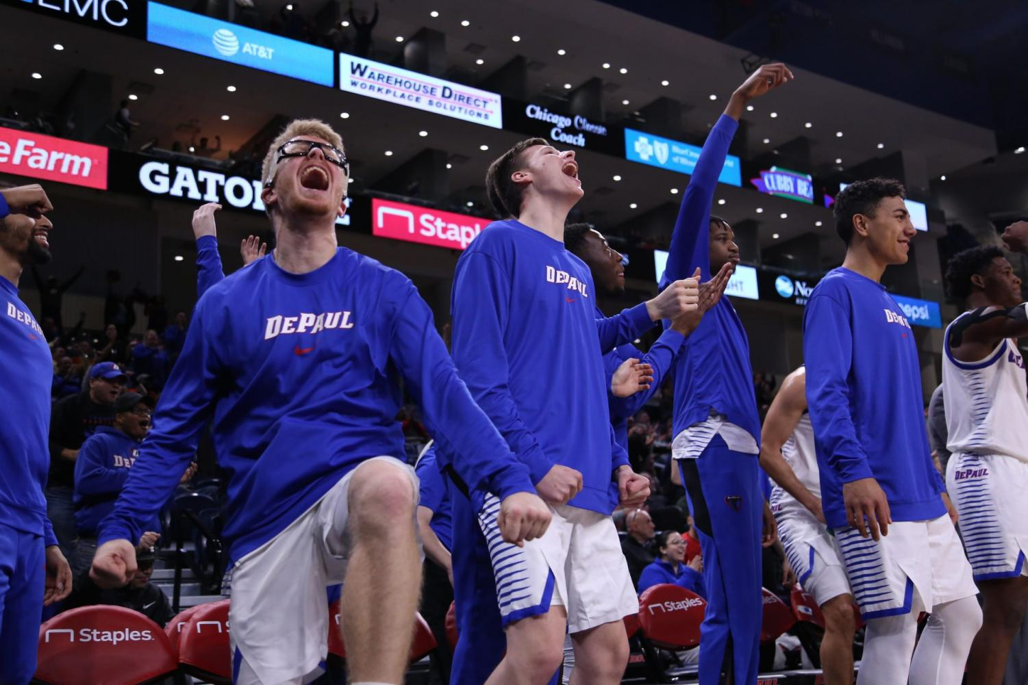 The bench celebrates during the second half of a game against Central Michigan on Tuesday, Nov. 26.