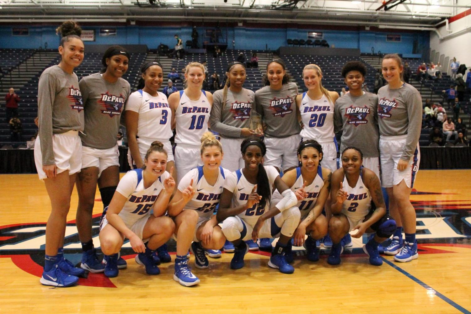 The women's basketball team celebrates after winning the Maggie Dixon Classic on Saturday.