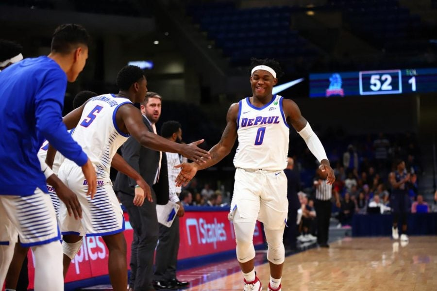 DePaul freshman guard Markese Jacobs celebrates with the bench in the second half against Fairleigh Dickinson at Wintrust Arena.